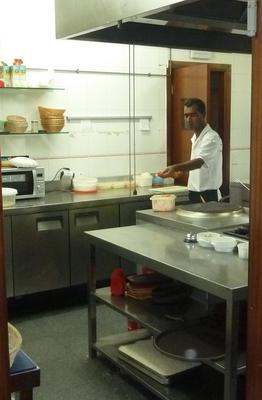 Jahinger preparing a Tandoori skewer