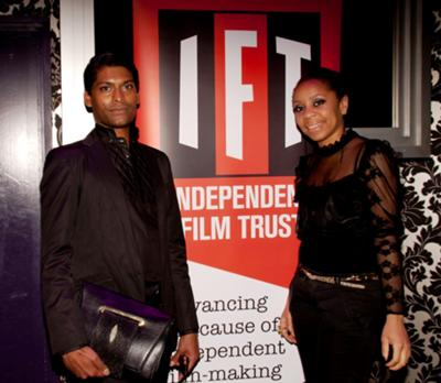 Emmanuel Ray and Karyn Louise at Independent Film Trust party.     Emmanuel Ray wears outfit by A. Hallucination. Bag by ARANGUIZ.