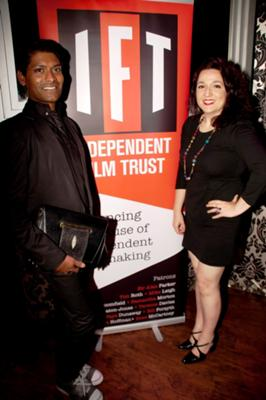 Emmanuel Ray and Paola Berta at Independent Film Trust party. Photo by Karyn Louise.        Emmanuel Ray wears outfit by A. Hallucination. Bag by ARANGUIZ. Shoes by Jara Stoop.