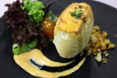 """Spanish potato omelette in wheat roll with mayonnaise of """"Piquillo"""" pepper"""