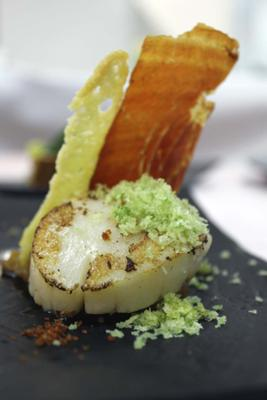 Scallops Galician style set on tomato sauce, parsley mini croutons and Pata Negra ham powder