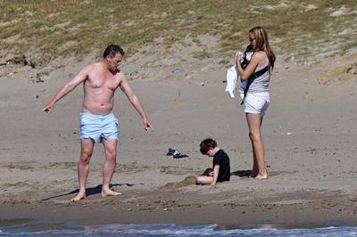 Hugh Grant and family on the beach