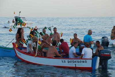 Fisherman boat accompanying the Virgin del Carmen